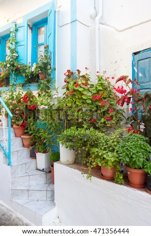 Flowery house fronts on a greek island Nissiros.