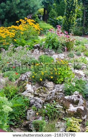 Flowery rockery in the garden - stock photo
