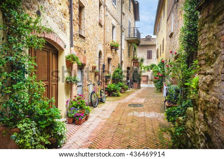 Flowery streets on a rainy spring day in a small magical village Pienza, Tuscany.