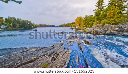 Flowing Blue Water into a rural lake