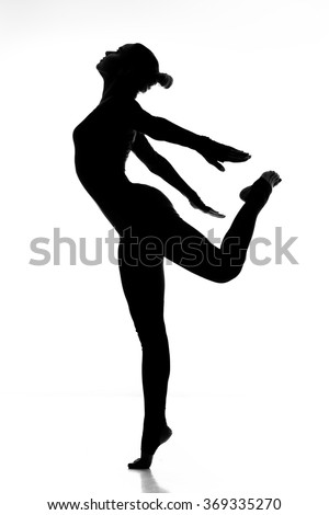 Flowing grace. Full length shot of a graceful fitness woman jumping isolated on white