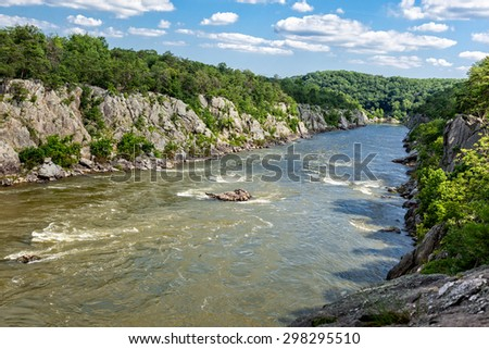 Flowing Potomac River at Great Falls National Park in Virginia on a summer day - stock photo