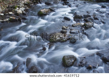 Flowing river - stock photo