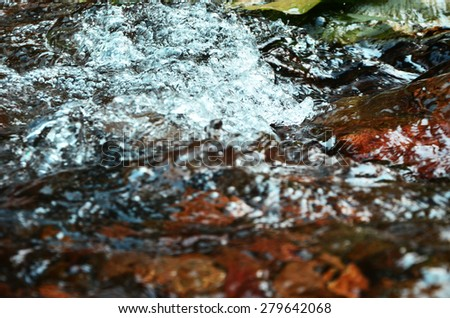 Flowing stream in nature river - stock photo
