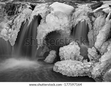 Flowing waterfall in black and white  - stock photo