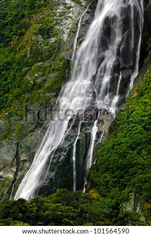flowing waterfall in new zealand - stock photo