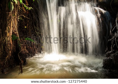 Flowing Waterfall In The Forest - stock photo