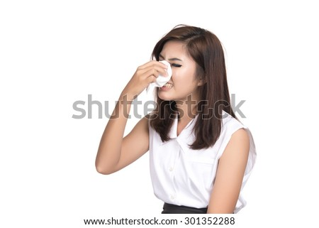 Flu cold or allergy symptom.Sick young asian woman with fever sneezing in tissue,allergies,the common cold,with blank copy space,Thai girl,Portrait of Asian woman,isolated on white background. - stock photo