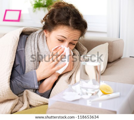 Flu or Cold. Sneezing Woman Sick Blowing Nose. - stock photo