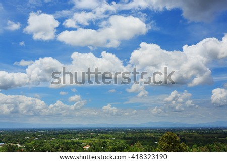 fluffy cloud above beautiful blue sky background - stock photo