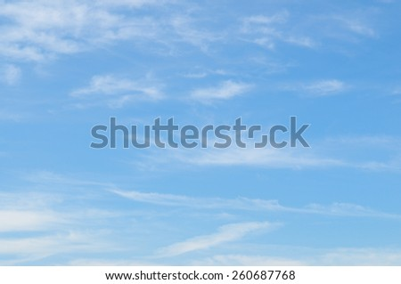 fluffy clouds in the blue sky - stock photo