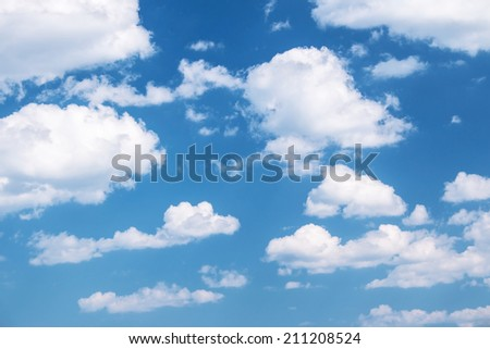 Fluffy clouds on the blue sky - stock photo