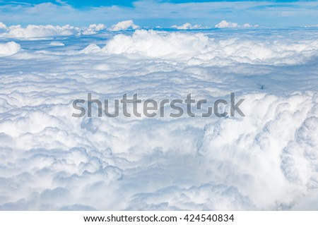 Fluffy cloudscape in aerial views from above - stock photo