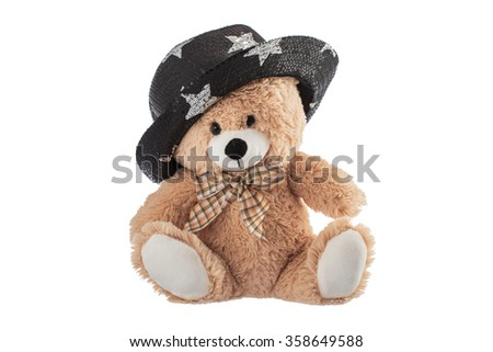Fluffy teddy bear with party hat isolated on a white background - stock photo