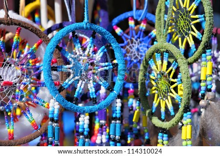 Fluffy variety of dream catchers on artisan market - stock photo