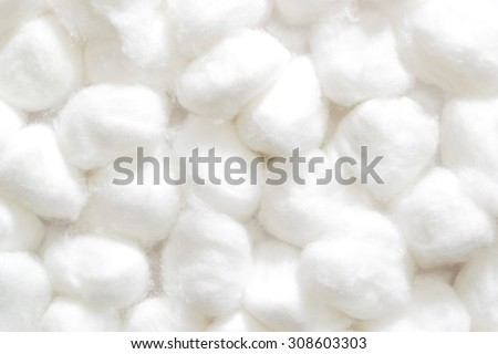 fluffy wedding of a kind originally made from raw cotton, used for cleansing wounds, removing cosmetics, and padding delicate objects.