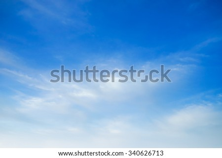 fluffy white cloud and bright blue sky