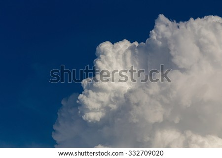 fluffy white cloud on dramatic sky, cloudy background - stock photo