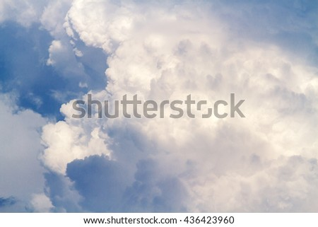 Fluffy white clouds flying on blue sky background - stock photo