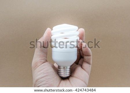 Fluorescent Bulb with lighting on human hand - stock photo