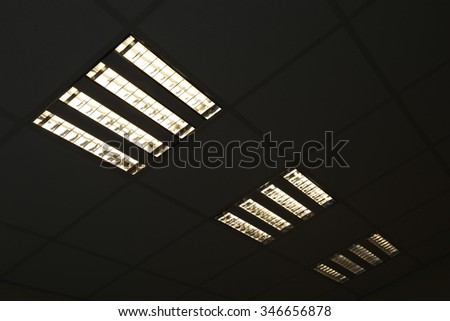fluorescent lamp on the ceiling dark night, interior background