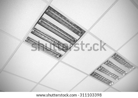fluorescent lamp on the ceiling, modern office interior background - stock photo