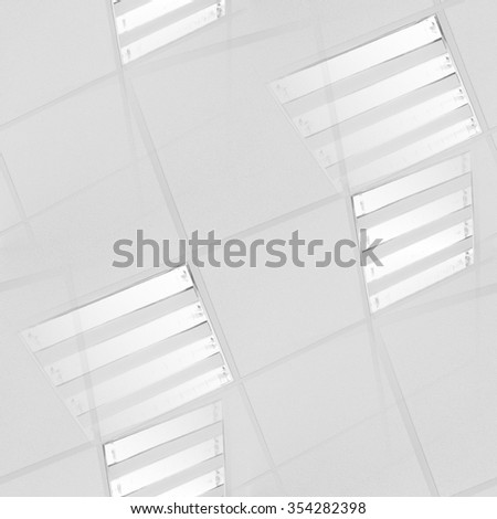 fluorescent lamp on the modern ceiling seamless abstract background to design technology project - stock photo