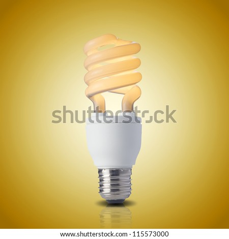 Fluorescent light bulb on yellow background. On light bulb. Concept for energy conservation - stock photo