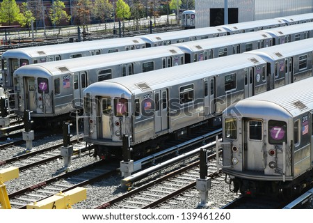 FLUSHING, NEW YORK - MAY 2: NYC  subway cars in a depot on May 2, 2013. It is the most extensive public transportation system in the world by number of stations, with 468 stations in operation - stock photo