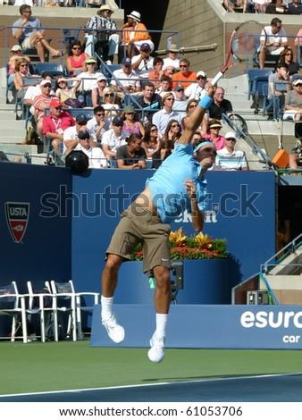 FLUSHING, NEW YORK- SEPT. 4: Roger Federer serves at the US Open at Arthur Ashe Stadium, Sept. 4, 2010, Flushing, New York. - stock photo