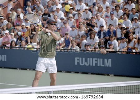 FLUSHING, NY - AUGUST 28: John McEnroe demonstrates some moves as he attends the US Open Kids Day in Arthur Ashe Stadium August 28, 1999 in Flushing NY.