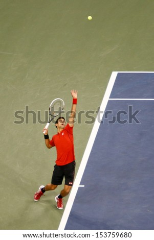 FLUSHING,NY-SEP 9: Novak Djokovic serves the ball during the mens finals of the US Open at Arthur Ashe Stadium on September 9, 2013 in Flushing, NY.  - stock photo