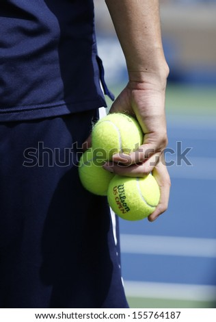 FLUSHING, NY - SEPTEMBER 5: Ball boy holding Wilson tennis balls at the Billie Jean King National Tennis Center on September 5, 2013 in Flushing. Wilson is the Official Ball of the US Open since 1979