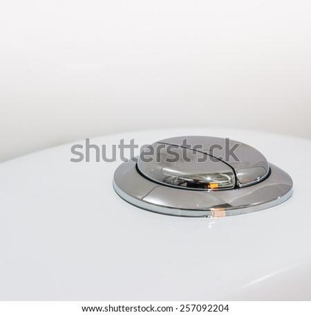 flushing toilet  button of toilet  WC - stock photo