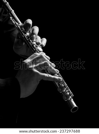 Flute in hands - music background - stock photo
