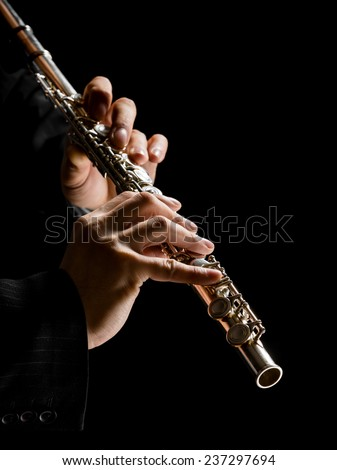 Flute in hands - music background