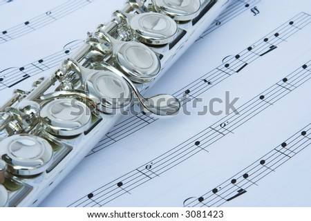 Flute keys on music notes - stock photo