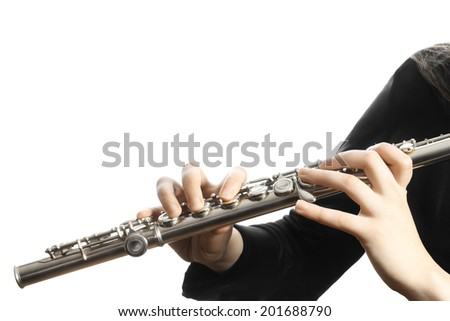 Flute music instrument hands close up Orchestra player flutist with musical instruments isolated on white - stock photo