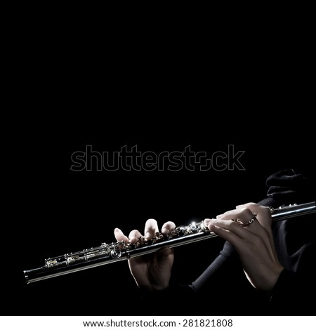 Flute music instrument hands. Flutist playing flute instrument isolated on black