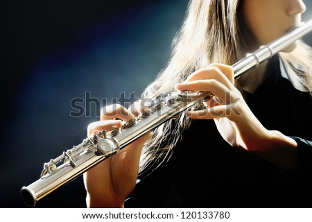 Flute music playing flutist musician performer with bright musical instrument