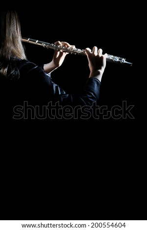 Flute player with music instrument Flutist playing concert. Classical orchestra instruments - stock photo