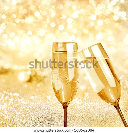 Flutes of champagne in holiday setting,Closeup - stock photo