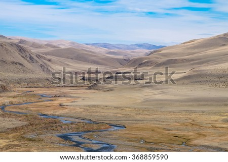 Fluvial terrace in Central Asia in the Altai. The result of glacial and river erosion.Photo illustrates well the geological processes - stock photo