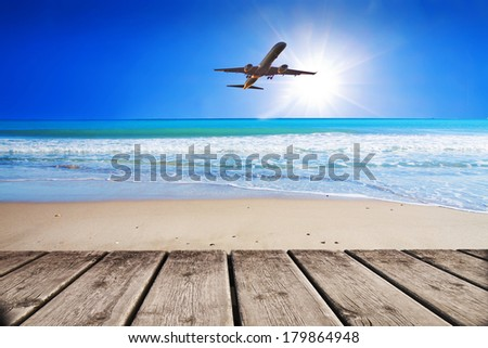 fly by plane for the holidays - stock photo