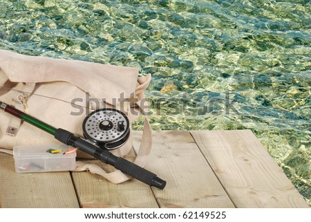 fly fishing equipment on a dock - stock photo