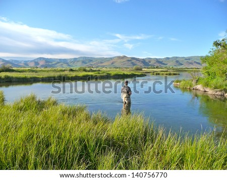 Fly Fishing In A Spring Fed Creek in Idaho - stock photo