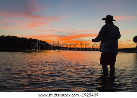 Fly fishing in the morning sun 14 - stock photo