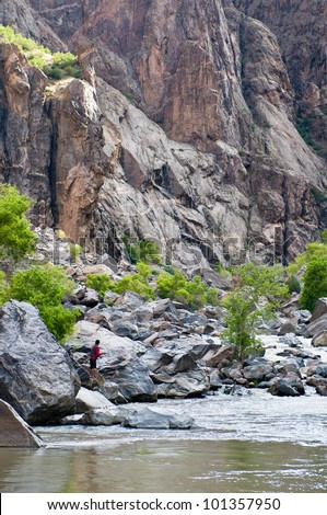 Fly fishing in the steep Black Canyon of the Gunnison Colorado - stock photo