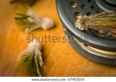 Fly fishing tackle, multiple flies and reel - stock photo