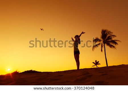 Fly to that exotic getaway.  - stock photo